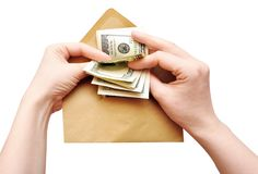 Hands is counting a cash in an envelope Stock Photo