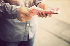 Hands counting chinese cny cash. On street Stock Images
