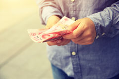 Hands counting chinese cny cash. On street Royalty Free Stock Image