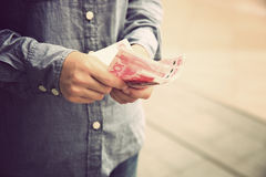 Hands counting chinese cny cash on street. Woman hands counting chinese cny cash on street Stock Image