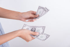 Hands counting dollar bills. Stock Images