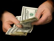 Hands counting dollars stock image