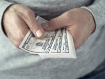 Hands counting dollars Royalty Free Stock Images