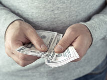 Hands counting dollars Stock Photos