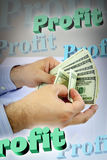 Hands counting money with 3d profit words Stock Photos