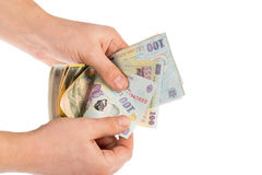 Hands counting money. Man hands counting romanian money lei Royalty Free Stock Image