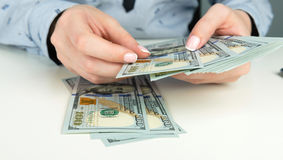 Hands counting money Stock Images