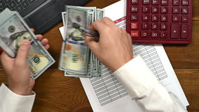 Hands Counts Bills. Accountant Counts Dollar Banknote And Writes Notes In Financial Report stock footage