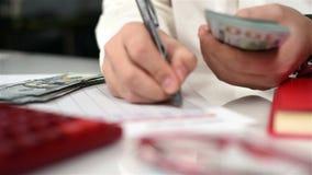 Hands Counts Dollar Bills. Accountant Man Counts US Dollar Banknotes. Close Up stock footage