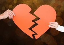 Hands of couple holding a broken heart Stock Image