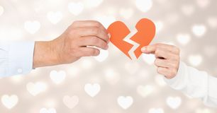 Hands of couple holding a broken heart Royalty Free Stock Photo