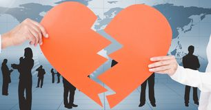 Hands of couple holding a broken heart Stock Photo