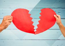 Hands of couple holding a broken heart Royalty Free Stock Image
