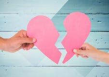 Hands of couple holding broken heart Stock Photos