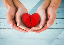 Hands of couple holding broken heart Royalty Free Stock Images