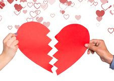 Hands of couple holding broken heart. Close-up of hands of couple holding broken heart Royalty Free Stock Images