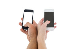 Hands of a couple holding smartphones Royalty Free Stock Photography