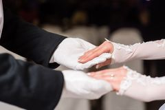 Hands of couple in white gloves dance waltz stock photos