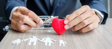 Hands cover Family paper and red heart. Healthcare and Insurance concept stock photos