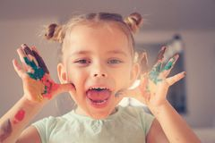 Paint hands. Smiling little girl. Royalty Free Stock Image