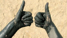 Hands covered with therapeutic mud. Picture taken at Techirghiol lake Royalty Free Stock Images