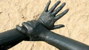Hands covered with therapeutic mud at Techirghiol. Picture taken at Techirghiol lake Royalty Free Stock Images