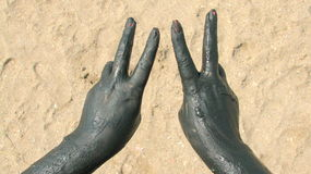 Hands covered with therapeutical mud Stock Photo
