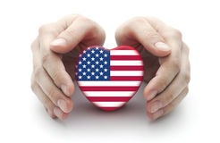 Hands covering U.S. heart Stock Image