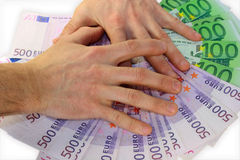 The hands covers paper money of Euro. For a light background Royalty Free Stock Photos