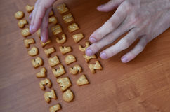 Hands on cracker keyboard buttons stock image