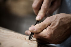 Hands of a craftsman Stock Photo
