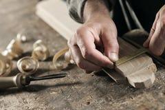 Hands of a craftsman Stock Photos
