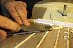 Hands of craftsman carpenter at work Royalty Free Stock Photos
