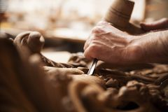 Hands of craftsman carve  with a gouge Royalty Free Stock Photo
