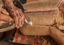 Hands of the craftsman carve Stock Images