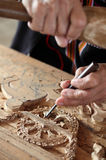 Hands of the craftsman carving Stock Image