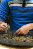 Hands of Craftsman Engraving Masterpiece Stock Photos