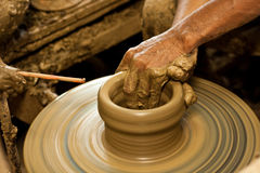 Hands of craftsman hold a jug Royalty Free Stock Images