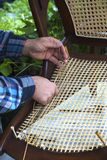 The hands of a craftsman stringing a chair bottom. Royalty Free Stock Photography