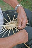 Hands of the craftsman while working the rattan to make a wicker Royalty Free Stock Photo