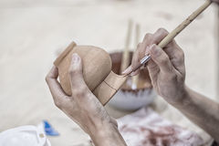 Hands of craftspeople painting  a clay pot Royalty Free Stock Image