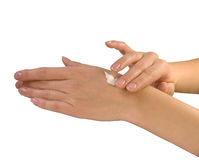 Hands with cream. Beautiful womanish hands with cream Stock Images