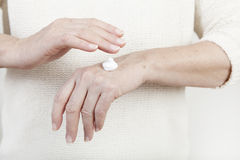 Hands with cream royalty free stock image