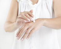 Hands with cream Royalty Free Stock Images