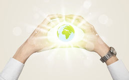 Hands creating a form with dollar sign. Hands creating a form with shining globe in the center Stock Images