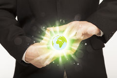 Hands creating a form with dollar sign. Hands creating a form with shining globe in the center Stock Photos