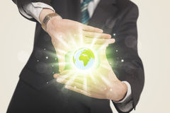 Hands creating a form with dollar sign. Hands creating a form with shining globe in the center Stock Photo