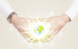 Hands creating a form with dollar sign. Hands creating a form with shining globe in the center Royalty Free Stock Photo