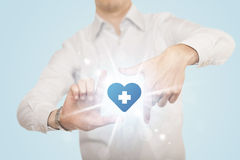 Hands creating a form with heart blue cross Stock Images