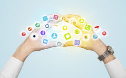 Hands creating a form with mobile app icons Stock Images
